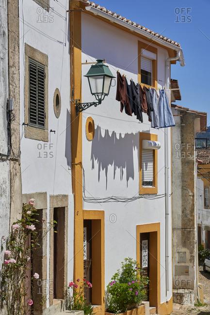 Laundry on home exterior in Castelo de Vide, Alentejo, Portugal