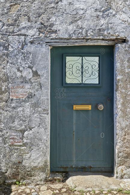 Blue door on old stone home in Castelo de Vide, Alentejo, Portugal