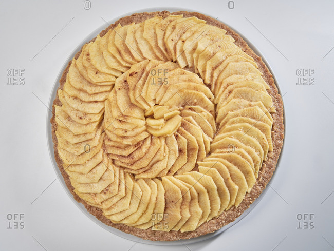 Homemade apple pie with a light touch of cinnamon on white background