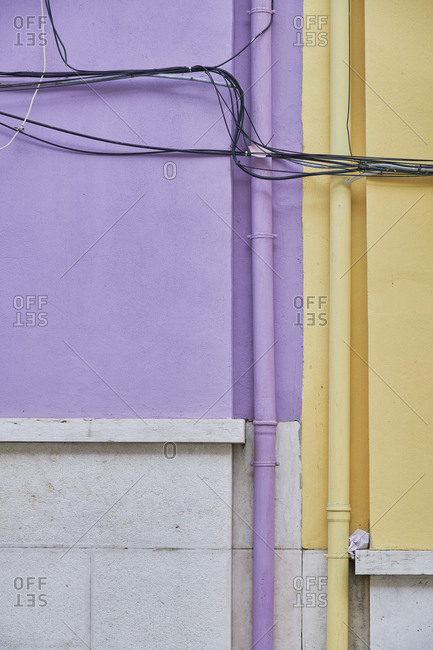 Detail of purple and yellow apartment buildings in Bairro dos Actores, Lisbon, Portugal
