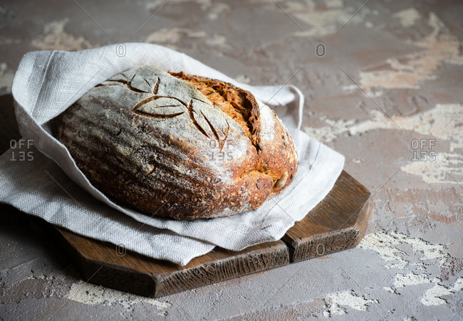 Homemade whole wheat sourdough on rustic background