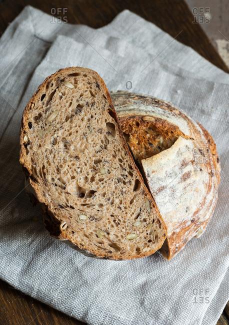 Homemade whole wheat sourdough bread sliced in half