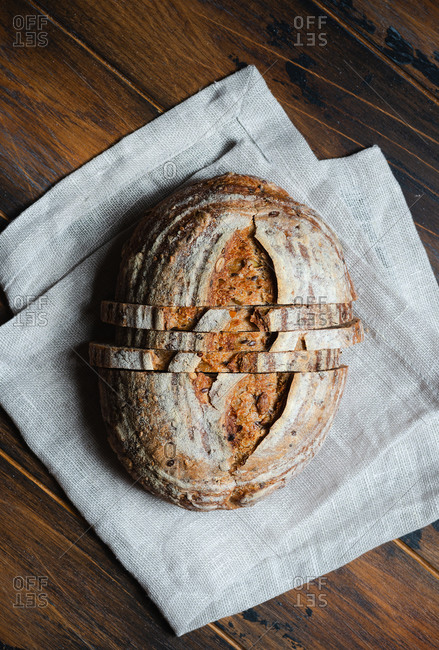 Whole wheat sourdough with seeds on rustic background