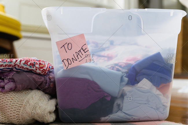 Clothes in bin marked for donation