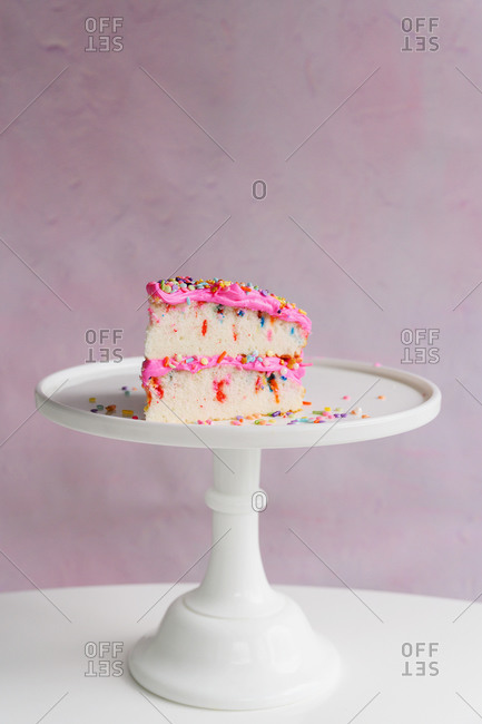 Slice of festive cake on cake stand