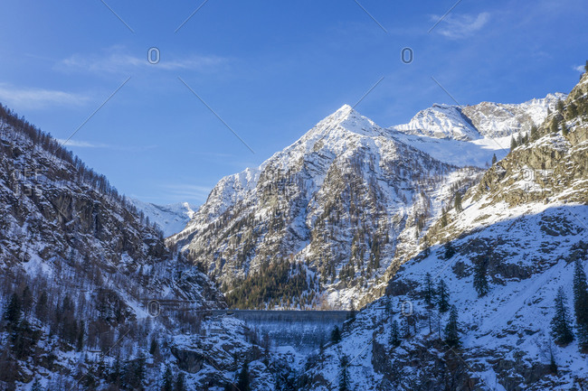 Italy, Piedmont, Italian Alps, Mountains on sunny day in winter