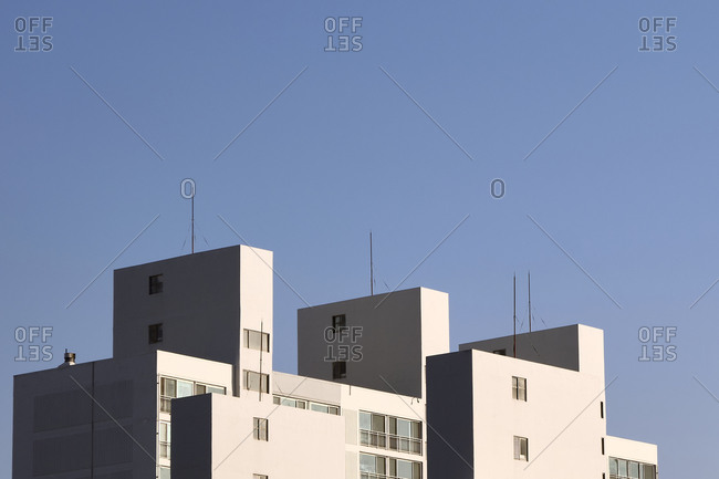 Busan, South Korea - April 23, 2020: Modern Apartment Buildings Against a Blue Sky in the Morning Light