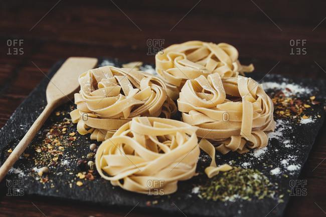 Delicious fresh Italian pasta, fettuccini with spices.