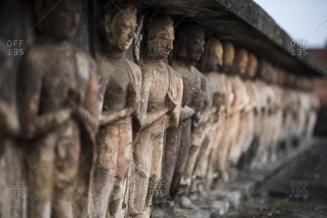 Buddhist stone carvings at the Wat Mahatat temple , Sukhothai Historical Park, Sukhothai, Thailand.