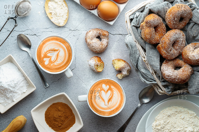Coffee with latte art and doughnuts