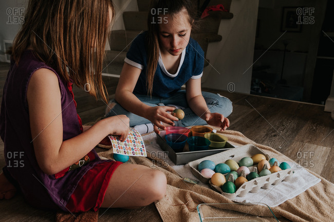 Sisters dying eggs inside the house