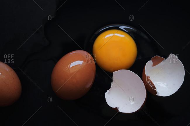 Broken egg on the black floor