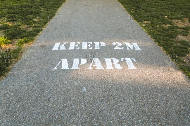 Keep 2m apart written on the ground