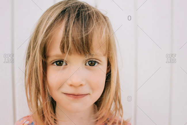 Candid close up portrait of young girl looking into the camera