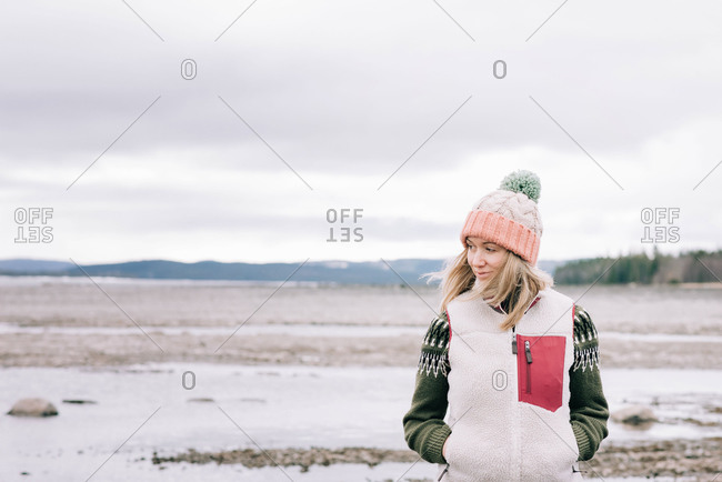 Portrait of woman standing alone in the great outdoors in Sweden