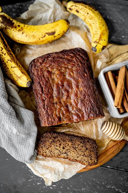 Homemade banana bread rustic flatlay with fresh ingredients
