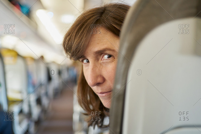 Mature woman on airplane seat