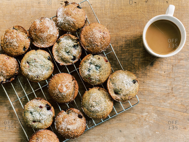 A rustic sweet breakfast with sourdough blueberry muffins and coffee.