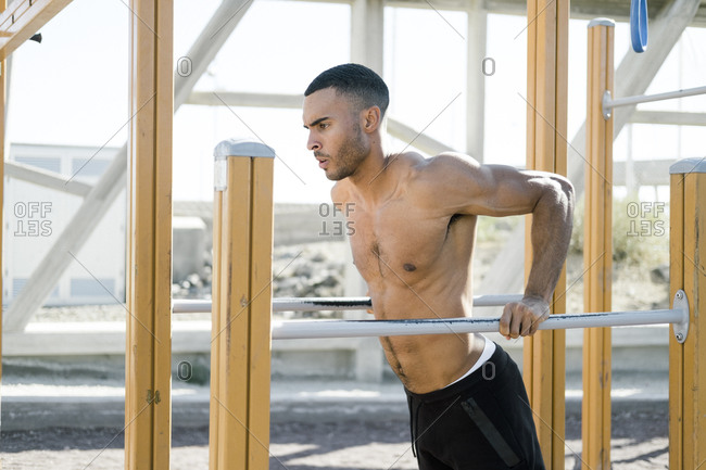 Upper part of African American male athlete during work out outdoors