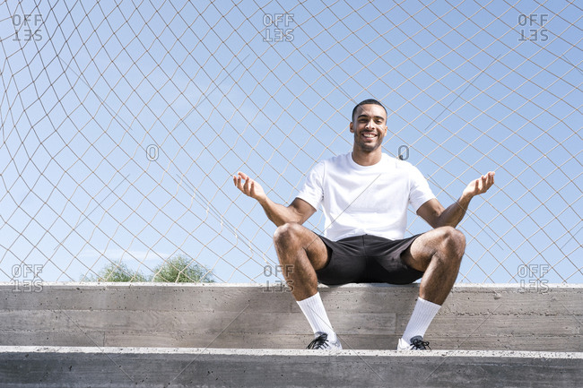 Full length African American male athlete portrait