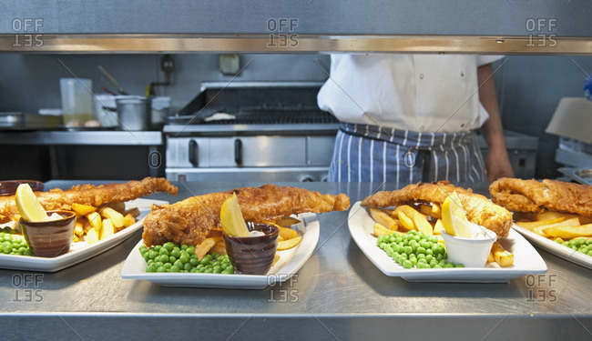 Fish and chips prepared at commercial kitchen in the UK