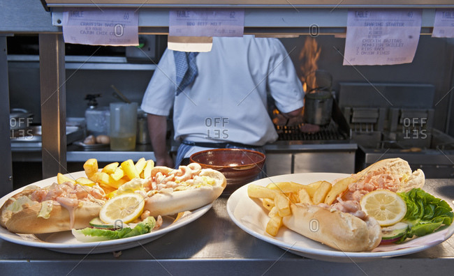 Pub food ready to be served in commercial kitchen at British pub