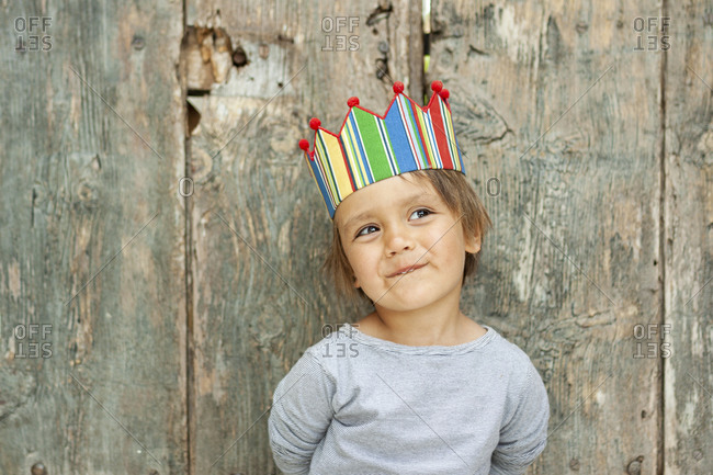 Portrait of smiling young boy wearing a colorful crown