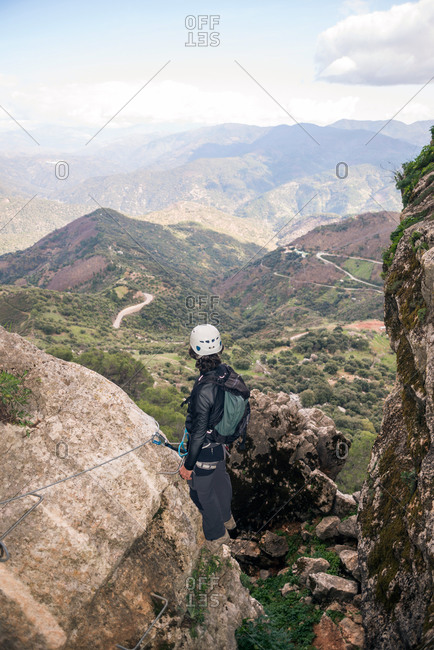 Back view of climber looking at the Andalusian natural landscape
