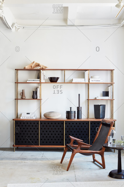 New York, NY - June 15, 2019: Vignette in clean, modern living area with shelving