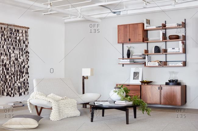 New York, NY - June 15, 2019: Clean, modern living room setting with shelving