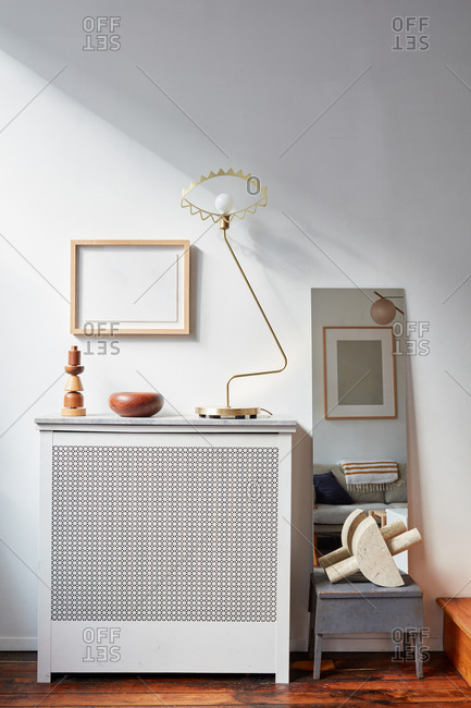 Radiator with lamp wood objects, picture frames