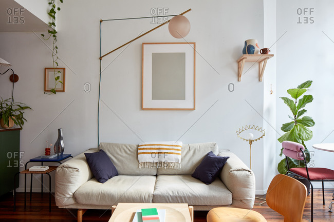 Couch and swinging lamp in loft apartment living room