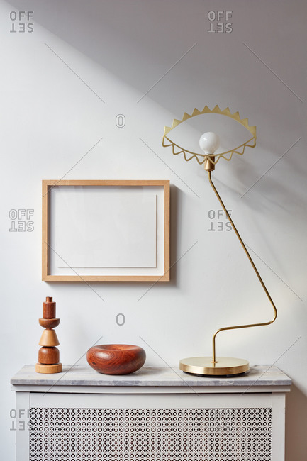 Radiator with marble top, lamp, picture frame and wood objects