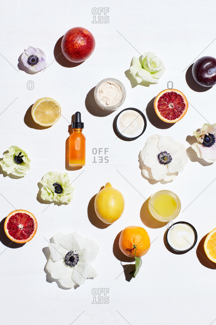 Still life with blood oranges, lemons, flowers and skin care products