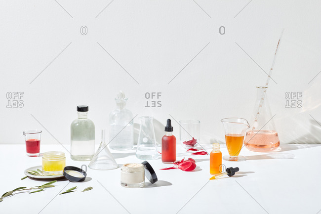 Apothecary of skin care products displayed on white