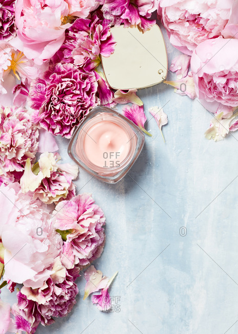 Still life of skin care product and flowers