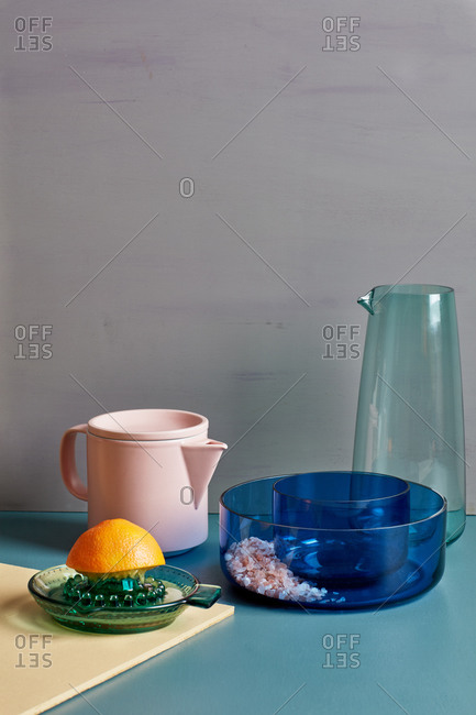 Still life of colored glass serving items