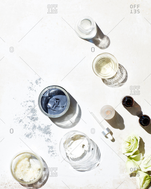 Still life of skincare products textured surface