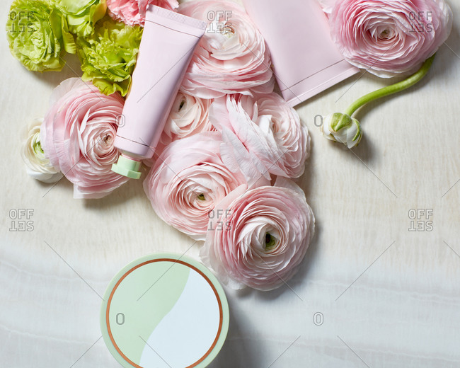 Still life with beauty products and roses
