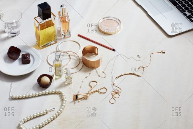 Perfume, beauty products, perfume, chocolates, laptop computer