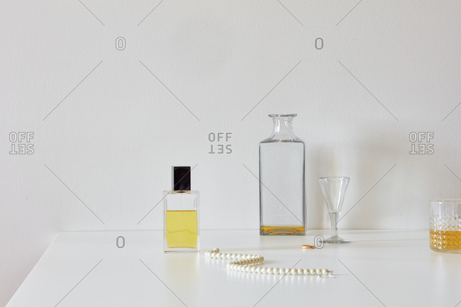 Still life with perfume, whisky, roses, necklace