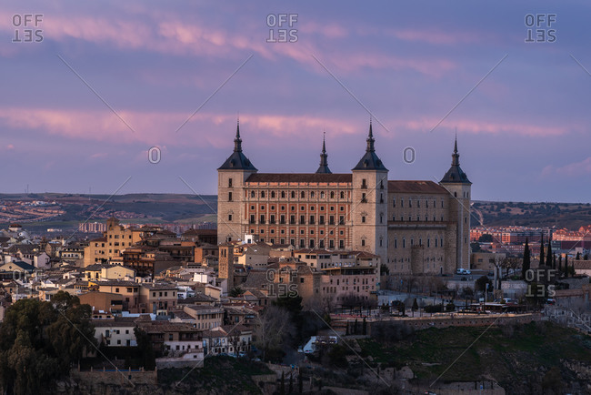 From above cityscape of aged town with medieval houses and castles during sunset