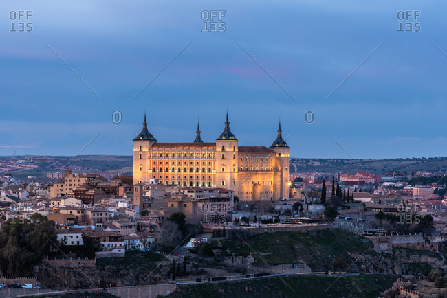 cityscape of aged town with medieval houses and castles during sunset