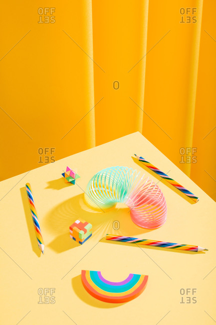 Colorful school supplies in bright yellow table