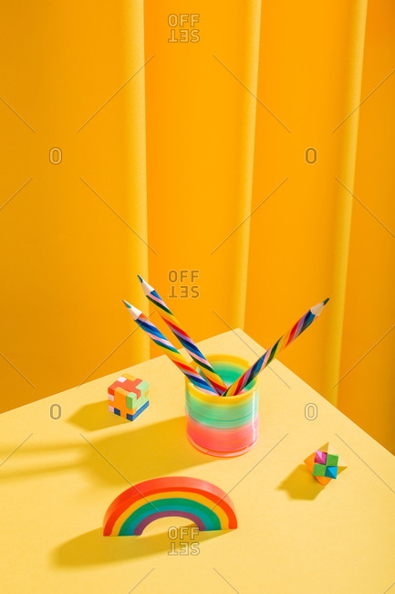 Minimal and colorful yellow desktop with pencils and sophisticated erasers