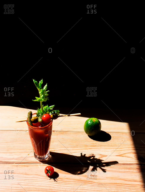 Virgin blood mary placed on a wooden table with black background