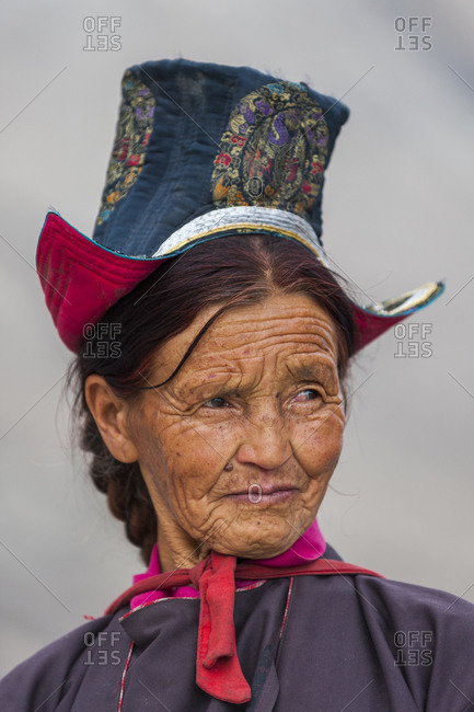 Nubra Valley - July 2, 2011: Buddhist woman travelling to a festival at Diskit Monastery