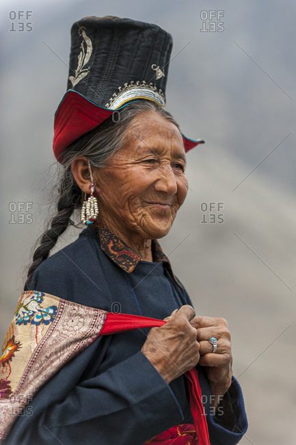 Nubra Valley - July 2, 2011: A Nubra woman wears traditional dress to attend a gathering at a local monastery