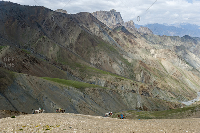 Pack horses laden with trekking equipment cross the Konze La on the Hidden Valleys trek