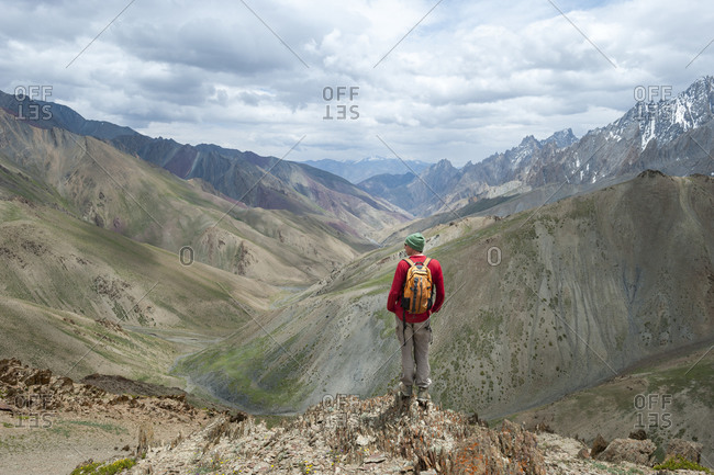 A trekker stops to admire the views from the top of the Konze La in the remote Himalayan region of Ladakh in northern India